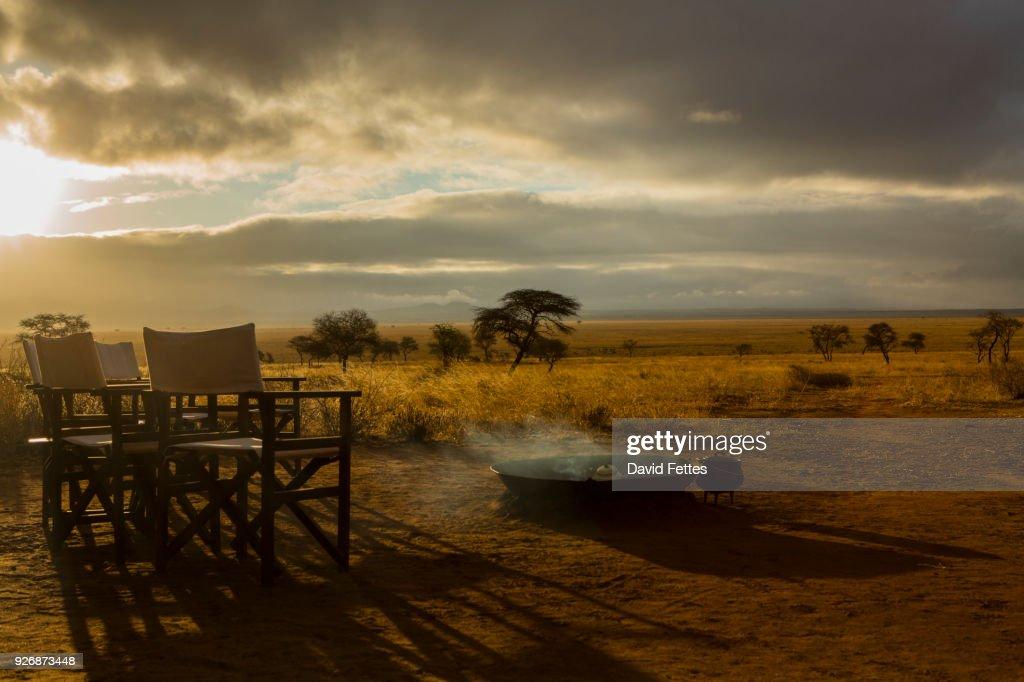 Camp fire and chairs, Tarangire National Park, Tanzania, Africa : Stock Photo