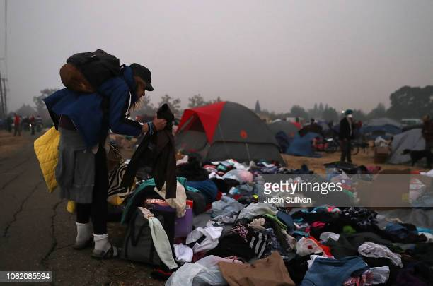 Camp Fire evacuee sorts through donated clothing at an evacuation shelter in a Walmart parking lot on November 15 2018 in Chico California Fueled by...
