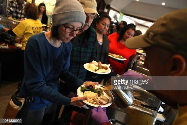 Camp Fire evacuee wait in line to receive a free Thanksgiving meal at Sierra Nevada Brewery on November 22 2018 in Chico California Fueled by high...