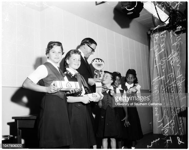 Camp Fire Girls selling boxes of mint candy 12 March 1958 Barbara Robbins Coral Beth Peck Mayor Norris PoulsonGail Harrington Linda Miller Judy Davis...