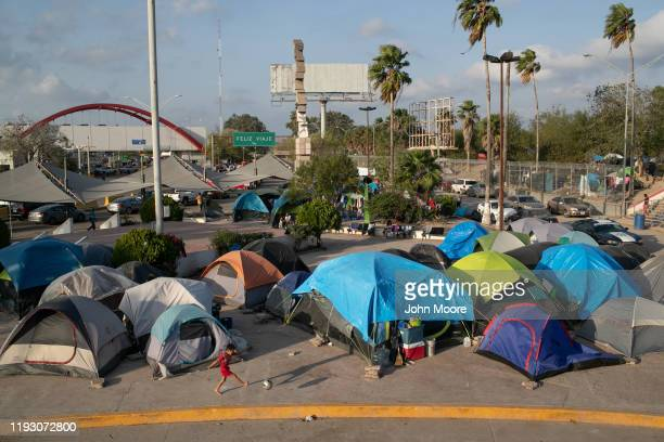 A camp for asylum seekers stands next to the international bridge to the United States on December 09 2019 in Matamoros Mexico More than 1000 Central...