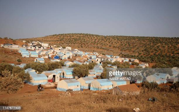 A camp for internally displaced people is pictured near Kah in the northern Idlib province near the border with Turkey on June 3 2019 on the eve of...