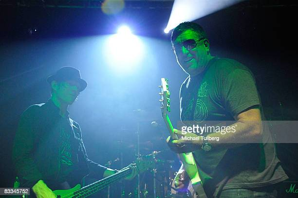 Camp Freddy bassist Chris Chaney and Sex Pistols guitarist Steve Jones perform with allstar cover band Camp Freddy at the benefit grand opening of...