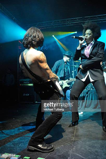 Camp Freddy guitarist Dave Navarro and vocalist Macy Gray perform with allstar cover band Camp Freddy at the benefit grand opening of celebrity...