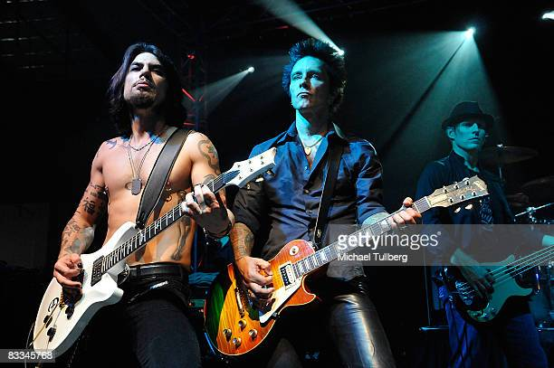 Camp Freddy guitarists Dave Navarro and Billy Morrison perform with allstar cover band Camp Freddy at the benefit grand opening of celebrity vehicle...