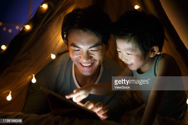 camp happy father and son in the living room - china east asia stock pictures, royalty-free photos & images