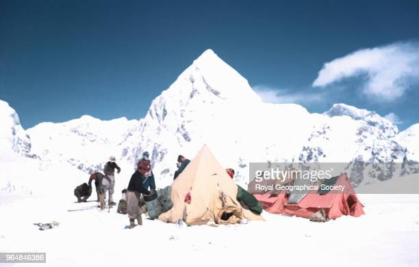 Camp III at entrance to Western Cwm Camp III at entrance to Western Cwm Standing to left of tent Wylie Tenzing Norgay Hillary and Noyce Pumori at...