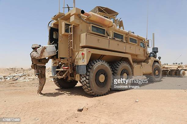 camp leatherneck, afghanistan, may 22, 2013 - hospital corpsman loads up a mine resistant ambush protected vehicle as he prepares to depart. - mine resistant ambush protected stock pictures, royalty-free photos & images