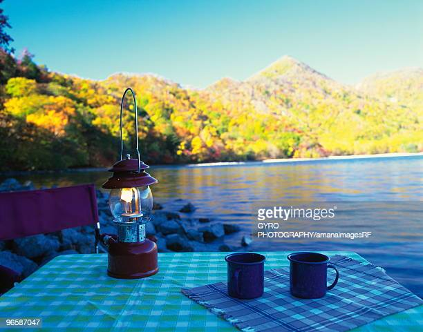 Camp light and table by lake in Nikko, Tochigi Prefecture, Japan