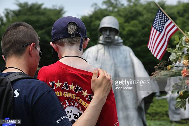 Camp mentor Billy Marlow and Ian Crowell who's father MSG Thomas Crowell was killed by a roadside bomb in Iraq in 2007 visit the Korean War Memorial...