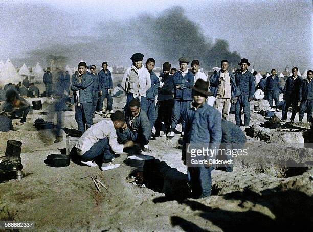 A camp of workers from the British Chinese Labour Corps recruited to participate in the Middle East campaign which began in 1916 with the defense of...