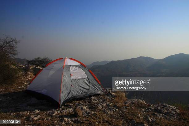 a camp pitched on edge of cliff - baseball pitcher stock photos and pictures