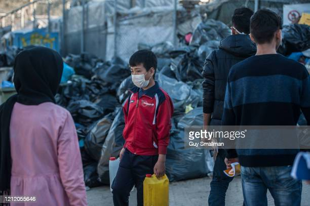 Camp residents wear surgical masks to protect from Coronavirus on March 12 2020 in Mytilene Greece The Moria Refugee Camp near Mytilene on the Island...