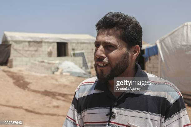 Camp responsible Adnan Kaddur speaks during an interview with Anadolu Agency on unhealthy living conditions in the refugee camp where Syrian children...
