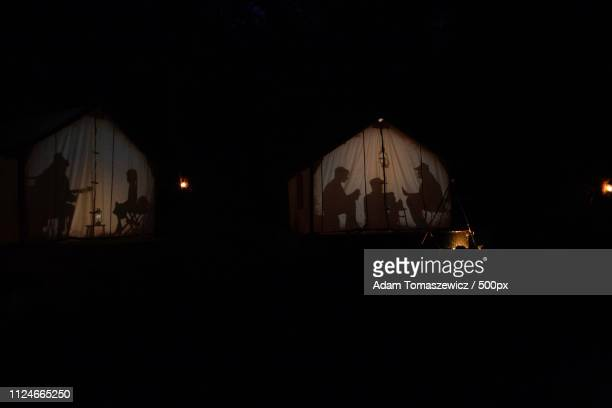 camp silhouette - shadow puppet stock photos and pictures
