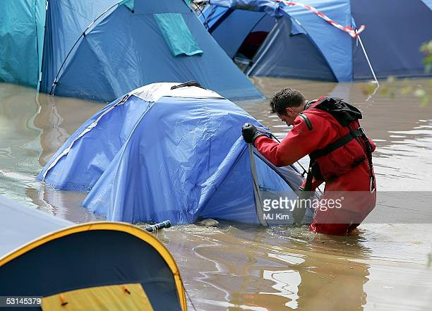 Camp site has flooded by heavy rain on the first day of the Glastonbury Music Festival 2005 at Worthy Farm Pilton on June 24 2005 in Somerset England...