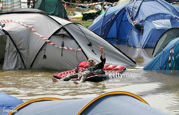 Camp site is flooded by heavy rain on the first day of the Glastonbury Music Festival 2005 at Worthy Farm Pilton on June 24 2005 in Somerset England...