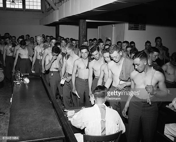 7/17/1945 Camp Stoneman CA Stripped to the waist GI's who have sailing orders for the Pacific Theatre of Operations are being given a physical...