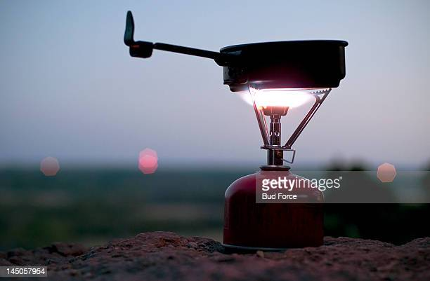 A camp stove illuminates the dusk evening on top of a bluff at Dynosaur State Park near Glen Rose, Texas.