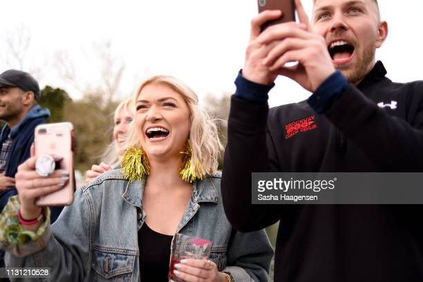 Camp TAZO campers watch as Alyssa Edwards makes a zipline entrance on March 15 2019 in Marble Falls Texas
