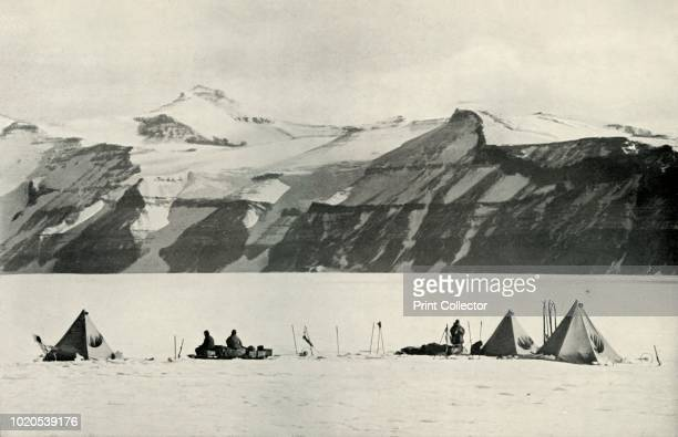 Camp Under The Wild Range' 20 December 1911 Three pyramid tents camped near Beardmore Glacier and Mount Wild two figures can be seen sketching on the...