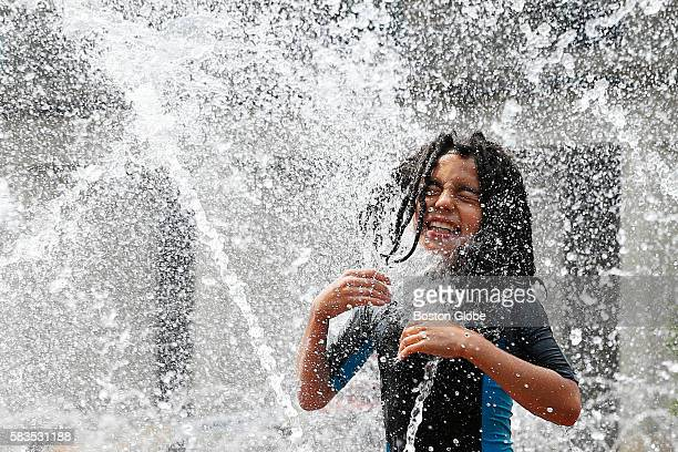 Camp Vibrant camper cools off in the Christian Science Center fountain in Boston Mass July 25 during a heat wave