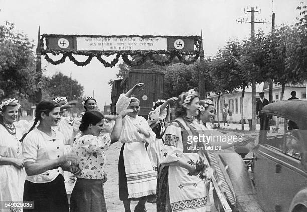Campaig aganst Soviet Union: Enthusiastic welcome to the german units when entering an ukrainian settlement. Mid July 1941