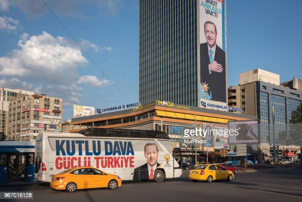 Campaign advertisements of Turkish President Recep Tayyip Erdogan appear on a bus and on a skyscraper in the central Kizilay district of Ankara...