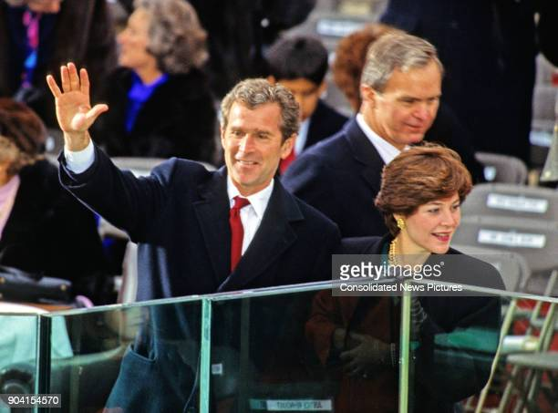 Campaign advisor George W Bush waves from the podium at his father's Presidential Inauguration ceremony at the US Capitol Washington DC January 20...
