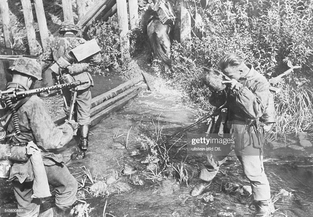 Advance squad of the Waffen-SS crossing a creek September