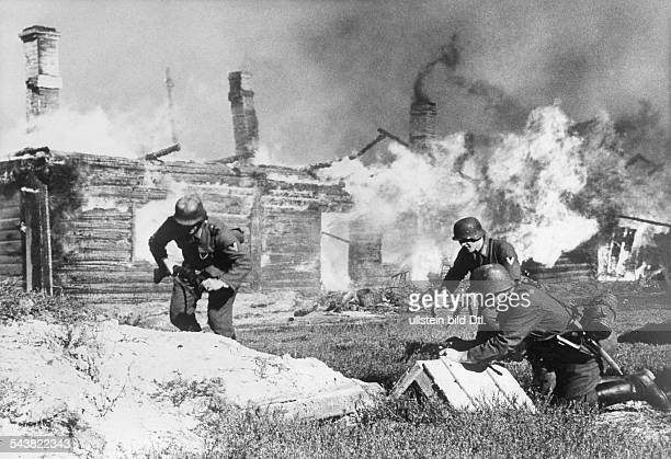 2WW Campaign against soviet union /eastern front theater of war Battle for a villageGerman soldiers during the attack no futrther informationMid...