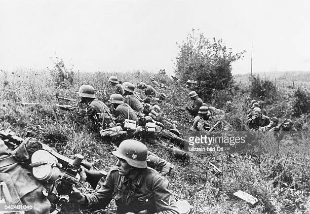 2WW Campaign against soviet union /eastern front theater of war Battle of KiewGerman infantry covered behind an embankment on the right some soviet...