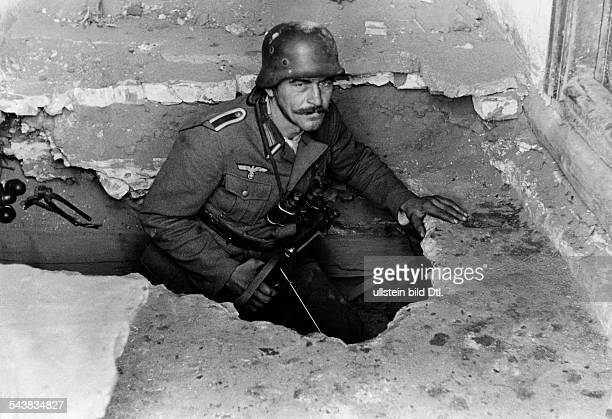 2WW Campaign against soviet union eastern front War theatre Advance to the Caucasus mountains A German corporal leaving the shelter December 1942 No...