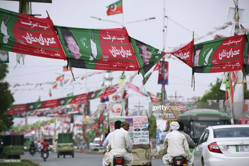 Campaign banners for Imran Khan head of the Pakistan TehreekeInsaf party remain on a street of Lahore Pakistan on July 26 a day after the country`s...