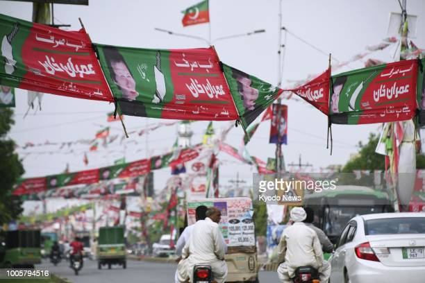 Campaign banners for Imran Khan head of the Pakistan TehreekeInsaf party remain on a street of Lahore Pakistan on July 26 a day after the country's...