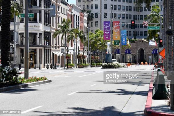 Campaign banners to prevent the spread of COVID-19 are seen on a deserted Rodeo Drive during the COVID-19 lockdown on April 22, 2020 in Beverly...