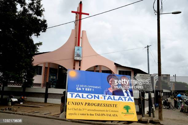 Campaign billboard is displayed in front of a church with photographs of incumbent Benin President Patrice Talon and running mate Mariam Talata in...