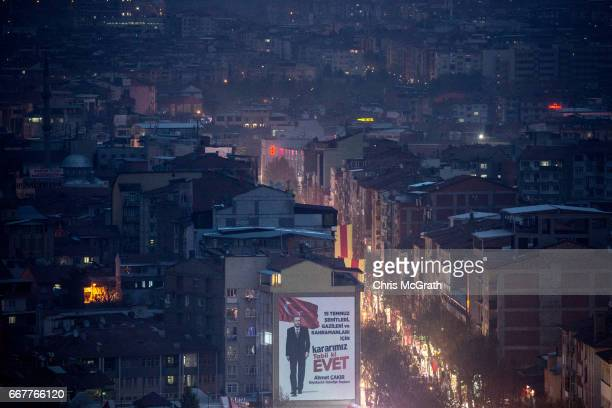 A 'EVET' campaign billboard showing the portrait of Turkish President Recep Tayyip Erdogan is seen on April 12 2017 in Malatya Turkey Campaigning by...