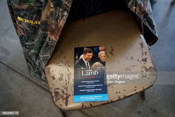 A campaign brochure sits on a seat before the start of a rally for Conor Lamb Democratic Congressional candidate for Pennsylvania's 18th district at...