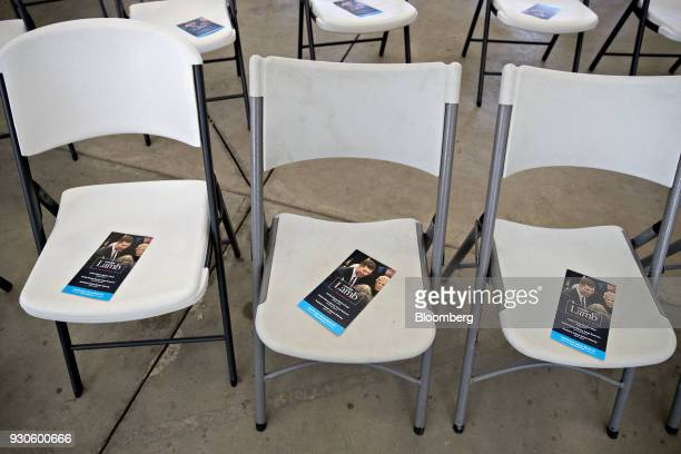 Campaign brochures for Conor Lamb Democratic candidate for the US House of Representatives sit on chairs before a rally with members of the United...