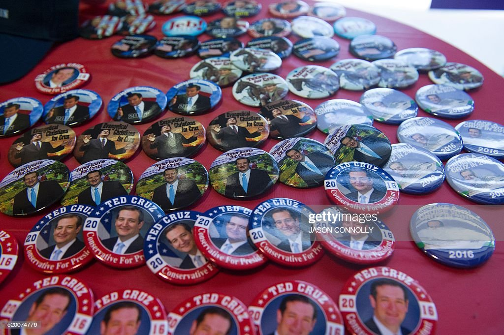 Campaign buttons are for sale during Republican presidential candidate Sen. Ted Cruz event at The Broadmoor World Arena in Colorado Springs, Colorado on Saturday, April 9, 2016. / AFP / Jason Connolly