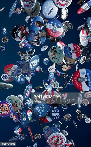 Campaign buttons falling through the air