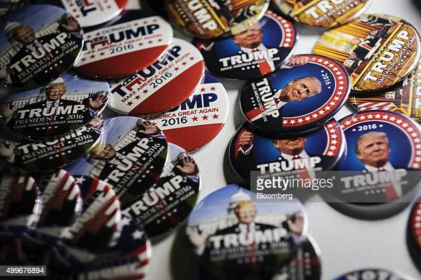 Campaign buttons featuring Donald Trump president and chief executive of Trump Organization Inc and 2016 Republican presidential candidate sits on...