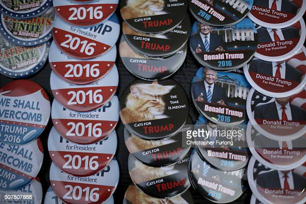 Campaign buttons sit for sale before a Trump campaign rally at the Gerald W Kirn Middle School on January 31 2016 in Council Bluffs Iowa Trump and...