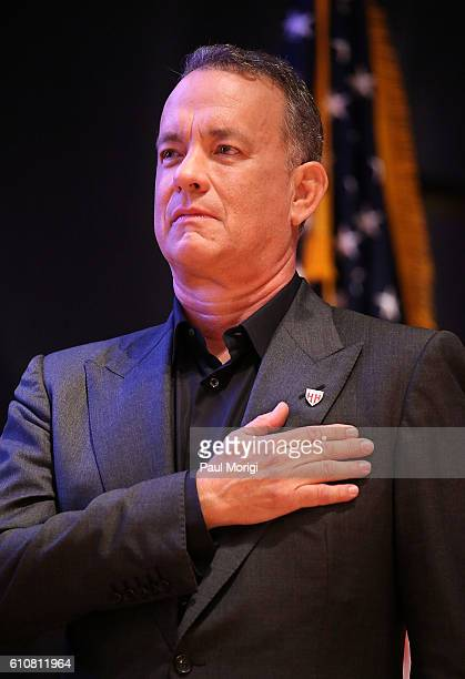 Campaign Chair Tom Hanks puts his hand on his heart during the singing of the US National Anthem at the launch of the Elizabeth Dole Foundation's...