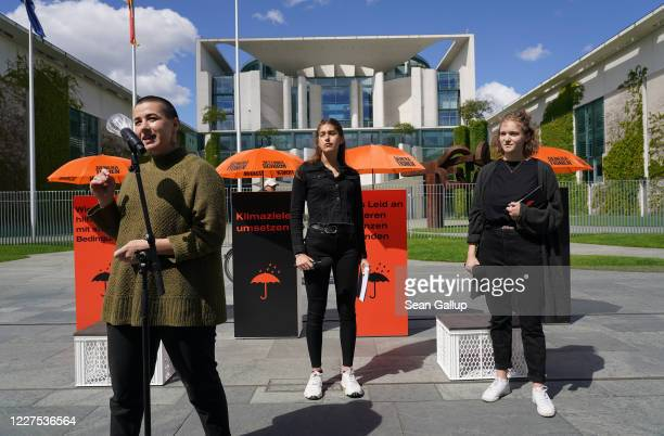 Campaign cospeakers Franziska Heinisch Rifka Lambrecht and Hannah Luebbert speak to supporters of the Generation Rescue Package campaign as they hold...