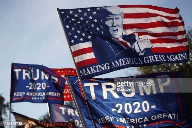 Campaign flags are displayed for sale during a rally with U.S. President Donald Trump, not pictured, in Lexington, Kentucky, U.S., on Monday, Nov. 4,...