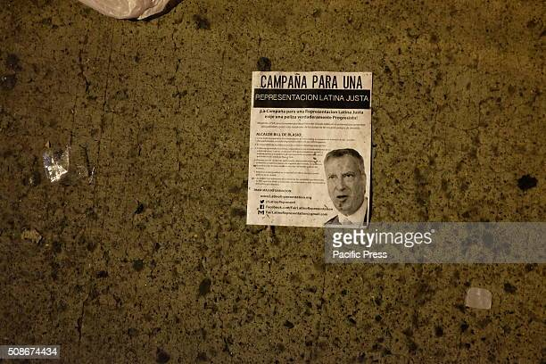 Campaign for Fair Latino Representation flyer criticizing mayor on sidewalk outside Lehman College NYC mayor Bill de Blasio delivered his third state...
