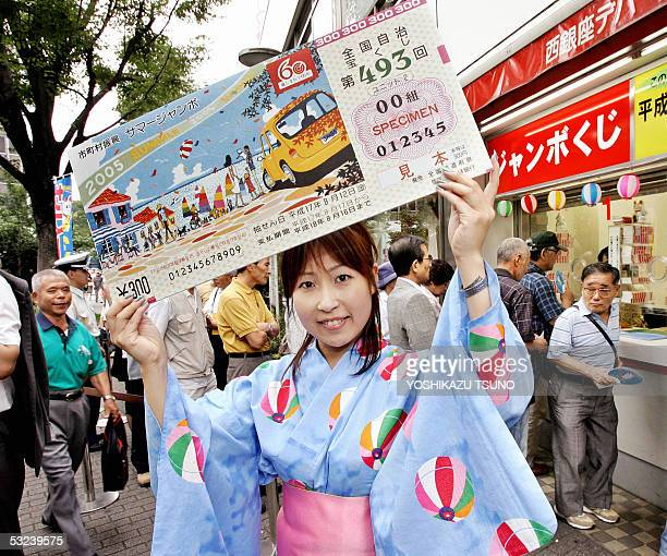 A campaign girl in yukata dress or summer kimono Yasuyo Matsuki displays a large sample lottery ticket as the 300 million yen Summer Jumbo Lottery...