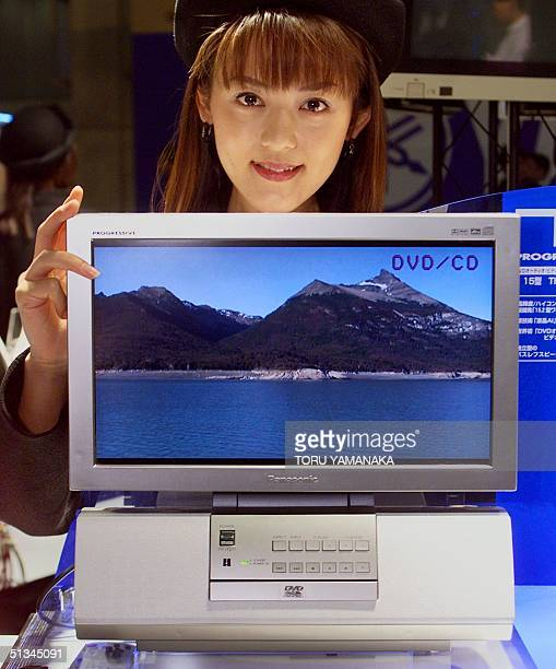 A campaign girl of Matsushita Electric Industrial Co Ltd best known for its Panasonic and National brand products shows the world's first 152inch...